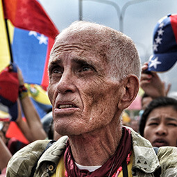 man fighting argentina protest protesting flag resistencia freedom anarchy content travel real UGC photography