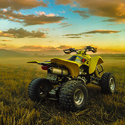 field bike quad sport landscape clouds yellow grass view man fun adrenaline real UG travel content photography