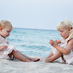 sisters beach holiday fun travelling sand playing blonde baby cute real UG travel content photography